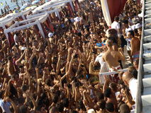 Beach party crowd. People dancing and shaking hands during a beach party in Gallipoli, Italy, in the summer Stock Images