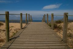 Beach path. Wood path leading into a beach Royalty Free Stock Image
