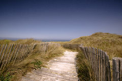 Beach with Path and Fence in Brittany. France on a sunny day in summer Royalty Free Stock Photo
