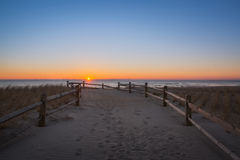 Beach path at Sunrise. Strathmere beach at sunrise in New Jersey Stock Images