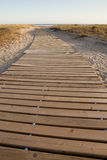Beach path. A wooden pathway laid on the sand and going towards a beach next to the sea. The picture was taken in the south of Spain (Andalusia), late in the Royalty Free Stock Photos