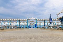 Empty beach, Italy, Riccione. Beach pathway to the canopy Royalty Free Stock Photos