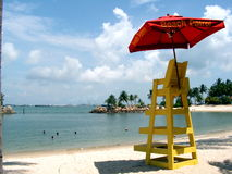 Beach Patrol Chair. Resort living with a lifeguard chair and umbrella. View of seaside resort Royalty Free Stock Images