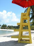 Beach Patrol Chair at beach. Resort living with a lifeguard chair and umbrella. View of seaside resort Stock Photos