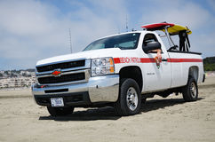 Beach Patrol truck with surf board Stock Photos