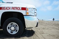 Beach Patrol vehicle at the ocean Stock Photography