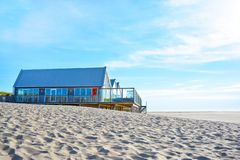 Beach pavillion `Faro2` with restaurant at the north end of island Texel in the Netherlands stock photography