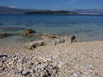 Beach. Pebble beach with view to Split and Marijan forest Royalty Free Stock Photos