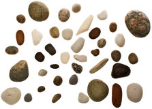 Beach pebbles. Various worn beach pebbles and rocks isolated on a white background Royalty Free Stock Photo
