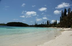 Beach. People enjoying the white sand beach and the warm blue waters of Ile des Pins, New Caledonia, France Stock Images