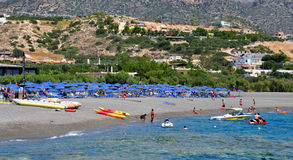 Beach and people in summer, Greece, Europe Royalty Free Stock Images