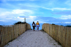 Walking Couple on beach path in Miami Royalty Free Stock Photo