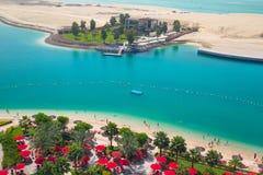 Beach at the Persian Gulf of Abu Dhabi. ABU DHABI, UAE - MARCH 28: Pool area of Khalidiya Palace by Rotana on March 28, 2014, UAE. Rotana Hotel Corporation has Stock Photos