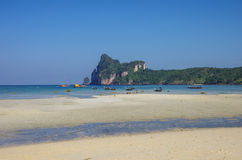 Beach of Phi Phi island in low tide with bay and longboat on bac Royalty Free Stock Photos