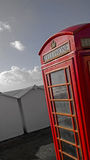 Beach phonebox. BT GPO red telephone box on a beach, public use call payphone Taken OCT 2014 on exmouth beach, devon, uk Stock Images