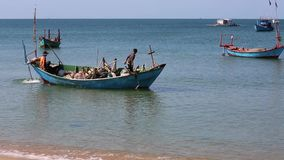 Beach at Phu Quoc island, Kien Giang province, Vietnam. Fishermen on boat,  Phu Quoc island, Kien Giang province, Vietnam. Phu Quoc is blessed with favourable stock video footage