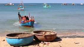 Beach at Phu Quoc island, Kien Giang province, Vietnam. Fishermen on boat in the morning,  Phu Quoc island, Kien Giang province, Vietnam. Phu Quoc is blessed stock footage