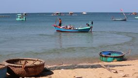 Beach at Phu Quoc island, Kien Giang province, Vietnam. Fishermen going out to sea for fishing,  Phu Quoc island, Kien Giang province, Vietnam. Phu Quoc is stock video footage