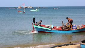 Beach at Phu Quoc island, Kien Giang province, Vietnam. Fishermen going out to sea for fishing,  Phu Quoc island, Kien Giang province, Vietnam. Phu Quoc is stock video