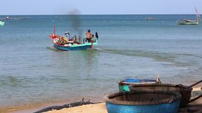 Beach at Phu Quoc island, Kien Giang province, Vietnam. Fishing boat on the beach in the morning,  Phu Quoc island, Kien Giang province, Vietnam. Phu Quoc is stock video