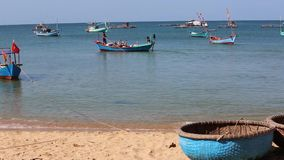 Beach at Phu Quoc island, Kien Giang province, Vietnam. Fishing boats near sea shore in the morning,  Phu Quoc island, Kien Giang province, Vietnam. Phu Quoc is stock video footage
