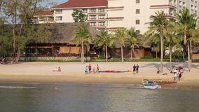 Beach at Phu Quoc island, Kien Giang province, Vietnam. Tourists on sea shore in the morning,  Phu Quoc island, Kien Giang province, Vietnam. Phu Quoc is blessed stock video