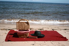 Beach Picnic. The wicker picnic basket sits at the beach Stock Photography