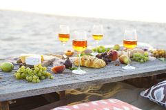 Beach picnic table with rose wine Stock Image