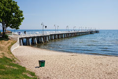 Beach and Pier at Baltic Sea in Gdynia Orlowo Stock Photo