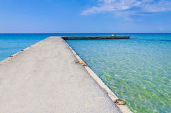 Beach pier at bright sky Royalty Free Stock Image