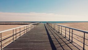 Beach Pier Leading to Ocean Royalty Free Stock Photography