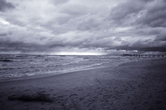 Beach and Pier, Lido di Camaiore. Beach and Pier at Lido di Camaiore in infrared color, Tuscan Riviera, Tuscany, Italy royalty free stock photos