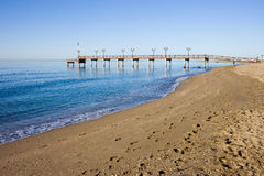 Beach and Pier in Marbella on Costa del Sol Stock Photo