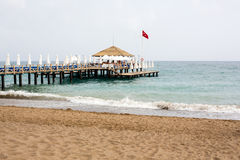 Beach with pier at the Mediterranean Resort in Turkey Stock Photos