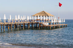 Beach with pier at the Mediterranean Resort in Turkey Stock Photo