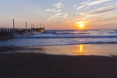 Beach Pier Ocean Sunrise. Beach Pier ocean waves sunrise color reflections shoreline skyline landscape Stock Photography