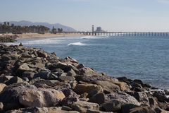 Beach with Pier and Power Plant Royalty Free Stock Image