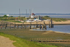 Beach with pier, sailboats and mudflats Stock Photography