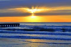 Beach pier Stock Images