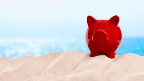 On the Beach - piggy bank on a sand dune in front of beautiful azure sea on a sunny day - seamless loop - ProRes stock footage