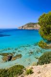 Beach pine trees turquoise sea bay mountains. Camp de Mar, Majorca island, Spain Stock Photography