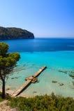 Beach pine trees turquoise sea bay mountains wide view. Camp de Mar, Majorca island, Spain Royalty Free Stock Photos