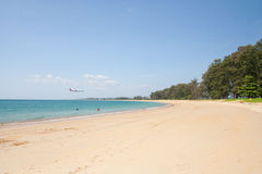 The beach and the plane Royalty Free Stock Photography
