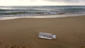 Beach with plastic bottle stock video footage