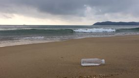 Beach with plastic bottle. Located in Sanya,China stock video