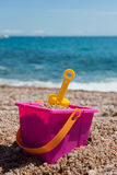 Beach with plastic toys Stock Images