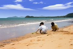 Beach play. Two boys with the sand to themselves Stock Image