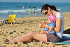 Beach Play Child Mother. A child and her mother play in the sand together on the beach Royalty Free Stock Image