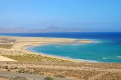 Beach Playa de Jandia - Playa de Sotavento on Fuerteventura, Spain. View on famous beach Playa de Jandia - Playa de Sotavento - Playa Lagoon on the Canary stock photo