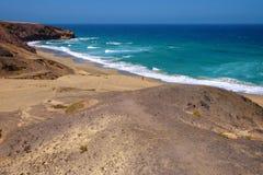 Beach Playa de La Pared on Fuerteventura, Spain. Beach Playa de La Pared with a tourist far away on the Canary island Fuerteventura, Spain Royalty Free Stock Image